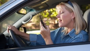 Woman Text Messaging on Her Cell Phone While Driving