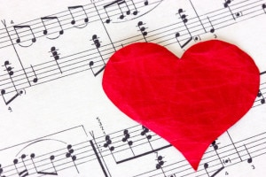 Music note book with red heart