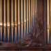 Detail of an old wooden church pipe organ.