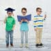kids in glasses with book, lens and bachelor hat